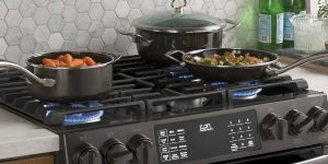 cooking on stovetop using pots and a pan