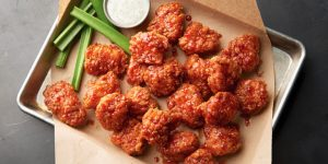 Spicy buffalo chicken nuggets with white sauce on the side