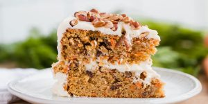A slice of banana cake with almond cream frosting