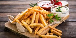 French fries with ketchup and mayo on the side