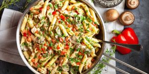 pasta salad garnished with parsley in a saucepan