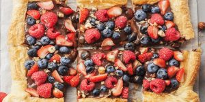 Chocolate and strawberry, blueberry and raspberry puff pastry tart