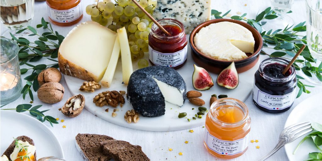 Different kinds of cheeses and jams