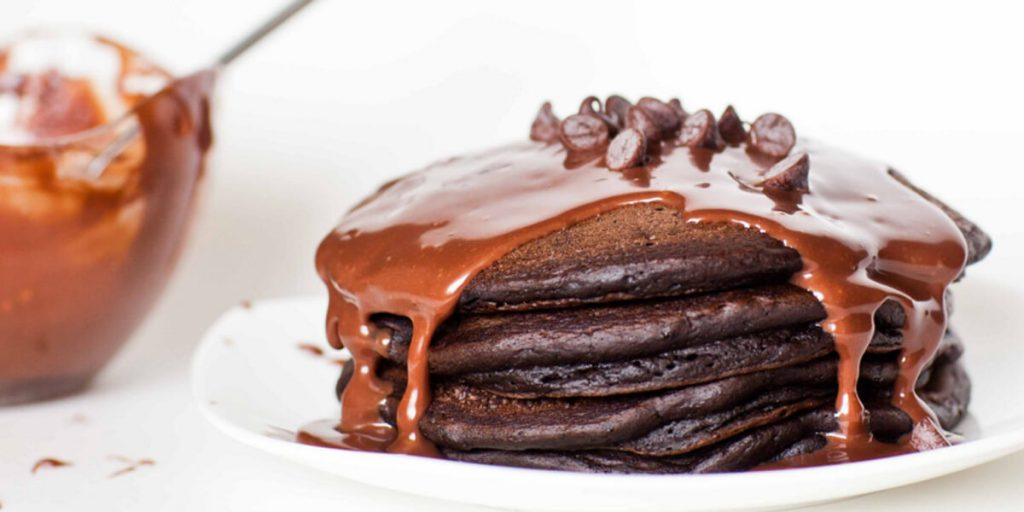 Chocolate pancake with chocolate syrup and topped with kisses chocolate
