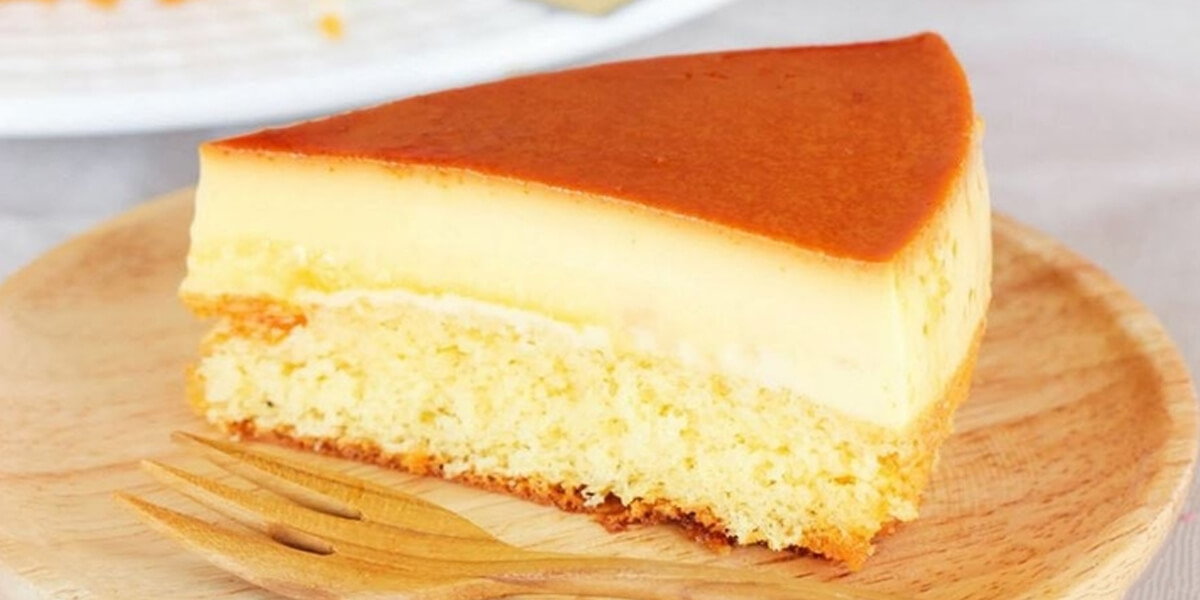 A slice of sponge cake topped with flan
